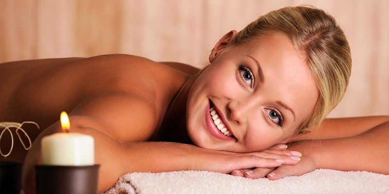 beautiful smiling female lying down in beauty salon